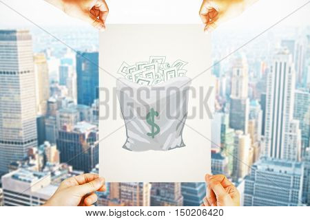 Four hands holding paper with creative money sack sketch on city background. Wealth concept