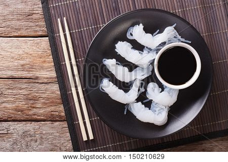 Shirataki Noodles With Soy Sauce And Chopsticks Close-up On A Plate. Horizontal Top View