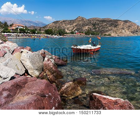 Heraklion, Greece- August 21, 2016. View of Agia Galini beach, just east to Agia Galini village. A popular tourist destination, with many taverns, cafes and hotels.