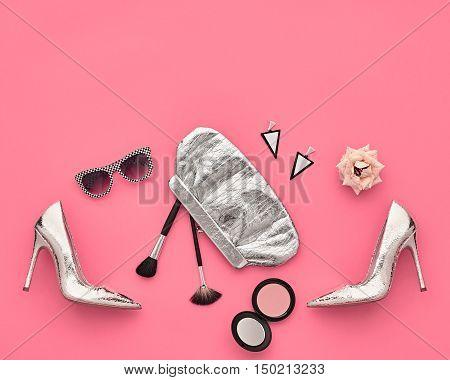 Fashion woman Clothes Accessories Set. Fashion Design Outfit. Essentials fashion Cosmetic Makeup. Stylish Glamor fashion Heels, Handbag Clutch, Trendy Sunglasses, Rose. Top view. Creative. Minimal