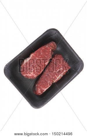 two fresh raw marble beef meat sirloin porterhouse steak on black market plastic tray isolated on white background