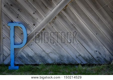 Blue Letter P on Old barn wood wall