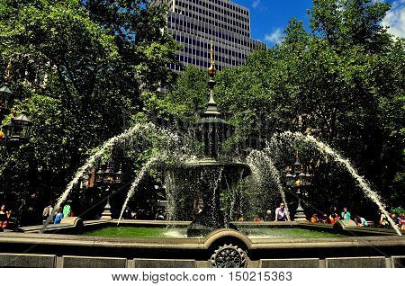 New York City - August 22 2004: The Victorian Fountain in City Hall Park in lower Manhattan