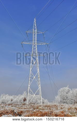 Frozen high voltage power pole in the winter time.