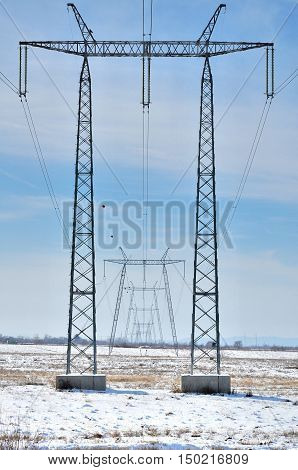 Silhouette of international electrical power line view. Electrical power lines and pylons.