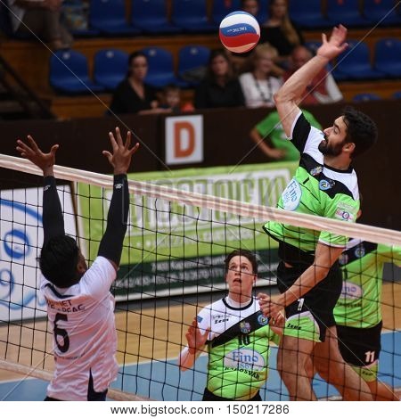 KAPOSVAR, HUNGARY - SEPTEMBER 30: Jozsef Nagy (with ball) in action at a Hungarian National Championship volleyball game Kaposvar (green) vs. PEAC (white), September 30, 2016 in Kaposvar, Hungary.