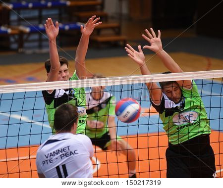 KAPOSVAR, HUNGARY - SEPTEMBER 30: Tamas Vajda (in right) in action at a Hungarian National Championship volleyball game Kaposvar (green) vs. PEAC (white), September 30, 2016 in Kaposvar, Hungary.