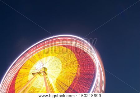 Night lights Ferris wheel on background blue sky in amusement park