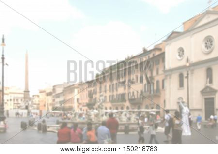 Generic urban background of Rome with an intentional blur effect applied. Not recognizable people.