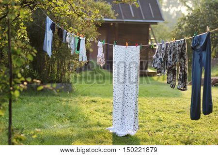 outdoor clothesline clothespin in autumn rustic landscape