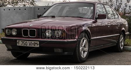 Kazakhstan, Ust-Kamenogorsk, october 2, 2016: BMW 7 E32, old car, old german car in the street, old BMW, sedan