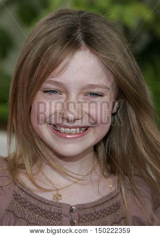Dakota Fanning at the Los Angeles premiere of 'Charlotte's Web' held at the ArcLight Cinemas in Hollywood, USA on December 10, 2006.