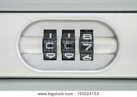 Closeup code number for locking the old suitcase background with 007 password