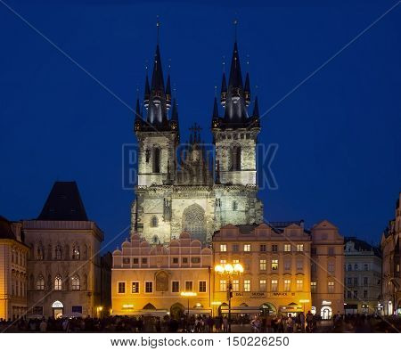 PRAGUE CZECH REPUBLIC - SEPTEMBER 27 2016: Evening view of Old Town Square (Stare Mesto) with Church of Our Lady before Týn and an unidentified people