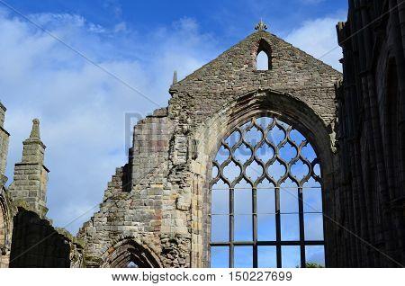Towering stone peak ruins of Holyrood Abbey.