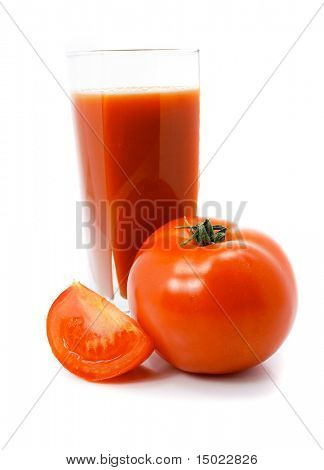 fresh tomato fruits with juice in the glass isolated over white background