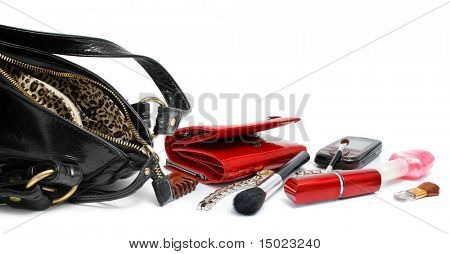 open black bag with female cosmetic accessories isolated on white background