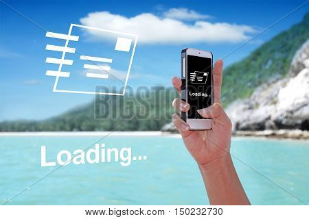 LOADING showing on the smartphone with tropical island background.