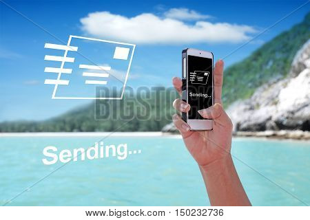 E-MAIL SENDING showing on the smartphone with tropical island background.