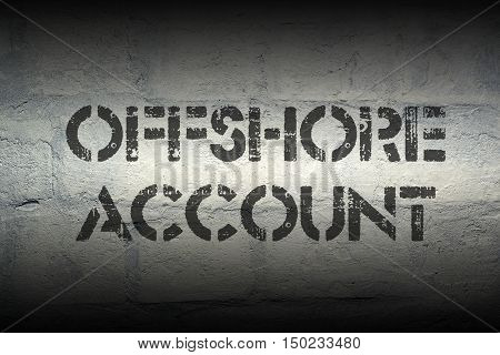 offshore account stencil print on the grunge white brick wall
