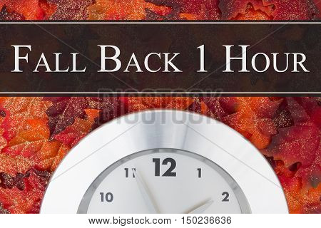 Daylight Savings Time message Some glittery fall leaves and retro silver clock with text Fall Back 1 Hour 1 Hour
