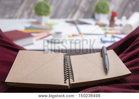 Blank Brown Notepad On Lap