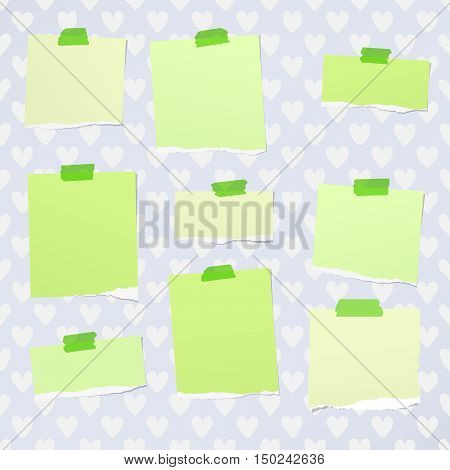 Ripped green notebook, note paper stuck with sticky tape on pattern created of heart shapes.