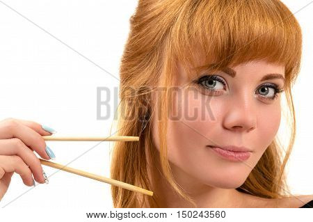sexy redhead woman with chopsticks isolated on white