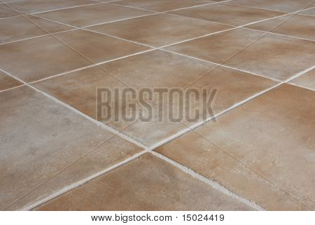 Ceramic tile background.  Close-up of newly installed tile with natural colored grout.