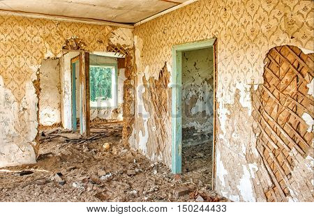 old abandoned wooden house indoor on sunny summer day