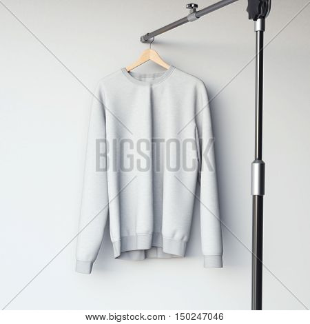Gray Blank Sweatshirt On Modern Hanger. 3D Rendering