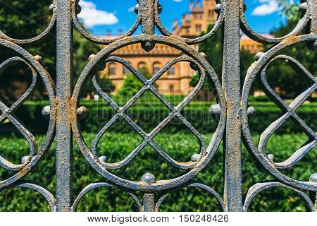 the iron fence enclosing the park