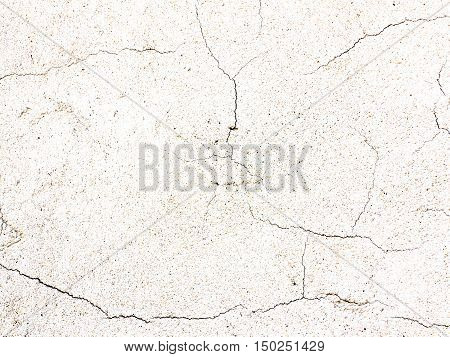 Detail of the cracked surface of rough plaster - fine cracks and scratches on the plaster