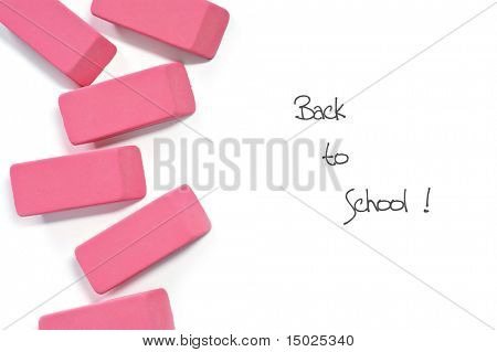 "Classic pink erasers on white background with ""Back to School"" message."