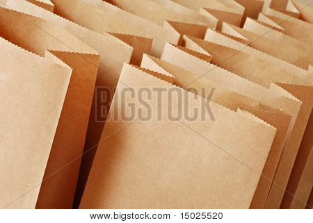 Brown paper bags in rows with tilted composition.  Macro with shallow dof.