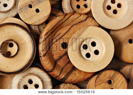 Wooden button background.  Macro with shallow dof.
