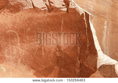 Petroglyph or rock art carvings of Native Americans on a canyon wall in Freemont National Park Capitol Reef Utah USA