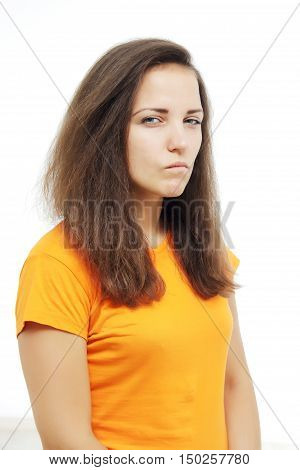 portrait of brunette girl with suspicious emotion. human emotion expression and lifestyle concept. image on a white studio background. mistrusted or offensed, brunette woman