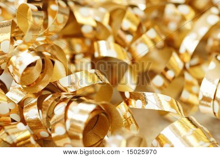 Soft abstract image of shiny gold ribbons with polka dot design.  Macro with extremely shallow dof.