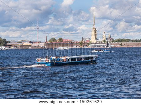 Saint Petersburg Russia Septembert 05 2016: tour boat in the background is the Peter and Paul fortress in St. Petersburg Russia.