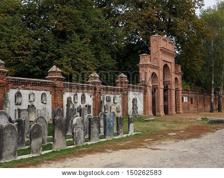 The gate of the cemetery. Lodz, Poland October 02, 2016 Jewish graves and the gateway to the historic Jewish cemetery in Lodz.