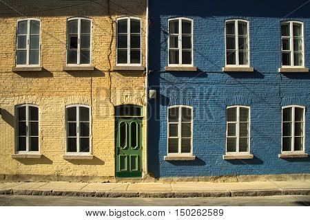 2 colourful houses in old Quebec city in Canada.  Picture from the street.