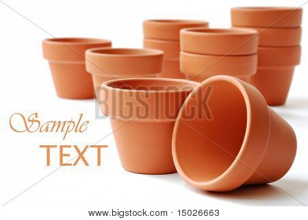 Little clay flower pots on white background with copy space.  Macro with shallow dof.