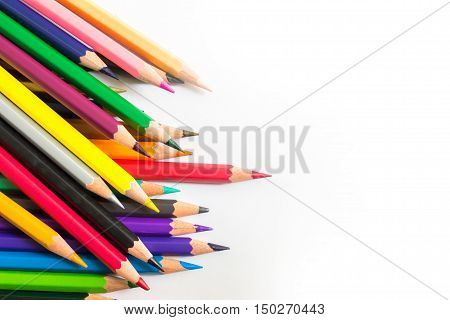 Color pencil with copy space isolated on white background / Red pencil standing out from a bunch of colored pencils isolated / Concept: leadership, individuality, unique, independent, winner, success.