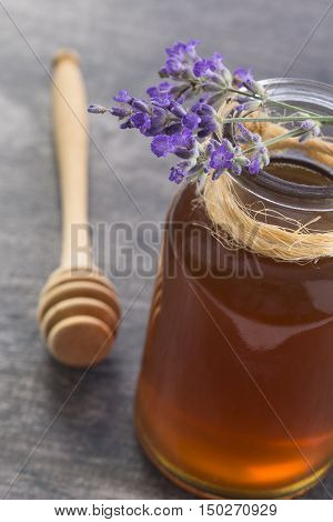 Honey in jar with honey dipper on vintage