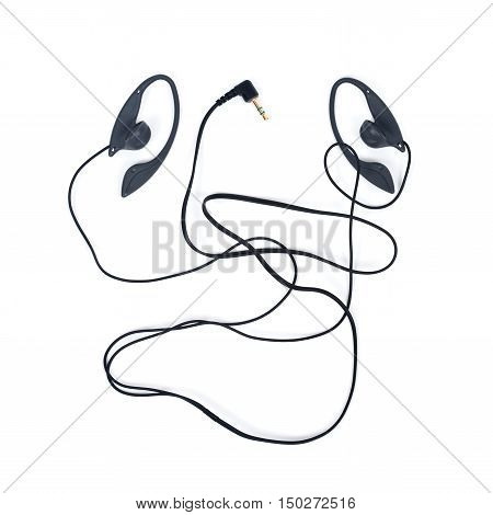 Black wired earpieces separated on white background