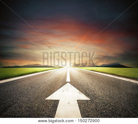 Road with an white arrow on asphalt