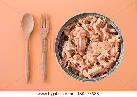 canned tuna isolated on orange background / Canned soy free albacore white meat tuna packed in water / open tuna tin on a white background / tuna fish isolated on white