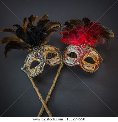 gorgeous amazing closeup view of theatrical colorful masks on dark grey background