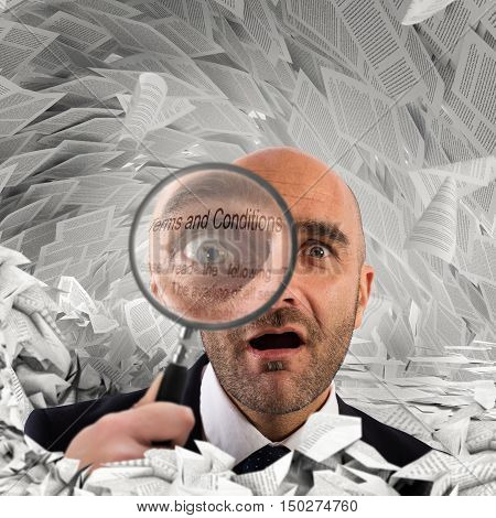Businessman with a magnifying glass on sheets documents background